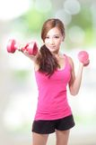 Young sport girl with dumbbells Royalty Free Stock Image