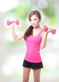 Young sport girl with dumbbells Royalty Free Stock Images