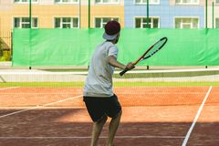 Young sport male tennis player on summer camp practice stock image