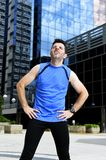 Young sport man breathing exhausted after running training on city urban background standing tired Stock Images