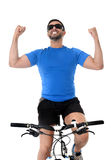 Young sport man riding mountain bike celebrating race victory Stock Images