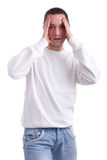 Young sport supporter  holding his head Royalty Free Stock Photography