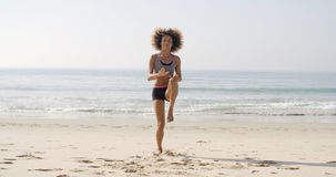 Young Sport Woman On The Beach Stock Image