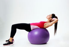 Young sport woman doing abs workout on fitball Royalty Free Stock Photos
