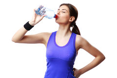 Young sport woman drinking water Royalty Free Stock Photo