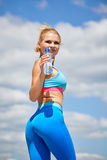 Young sport woman drinking water after running Royalty Free Stock Photos