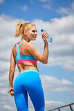 Young sport woman drinking water after running Royalty Free Stock Image