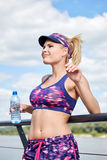 Young sport woman drinking water after running Royalty Free Stock Photo