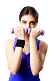 Young sport woman with dumbbells working out Royalty Free Stock Photography
