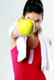 Young sport woman holding apple. On gray background Stock Photo