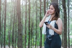 Young sport woman lifestyle using smart phone after running Stock Image