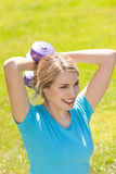 Young sport woman lift weight stock photography