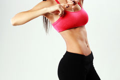 Young sport woman with perfect fitness body Royalty Free Stock Images