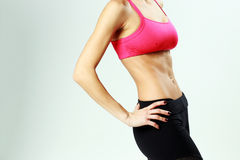 Young sport woman with perfect fitness body Royalty Free Stock Photography
