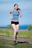 Young sport woman running outdoor Royalty Free Stock Images