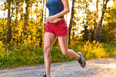Young sport woman runs on the road Stock Image