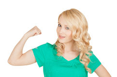 Young sport woman showing her biceps Royalty Free Stock Image