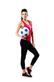 Young sport woman with soccer ball Stock Images