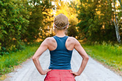 Young sport woman stays on the road Stock Images