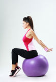 Young sport woman stretching on fitball Royalty Free Stock Photo