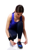Young sport woman tying shoelaces Stock Images