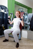 The young sporting woman in fitness center trains.Portrait Royalty Free Stock Images