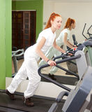 The young sporting woman in fitness center trains on a racetrack.Portrait Stock Photo