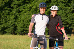 Young Sportive Couple On Bicycle Stock Photos