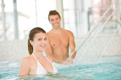 Young sportive couple have fun in pool Royalty Free Stock Photography