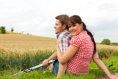 Young sportive couple hiking outside Royalty Free Stock Image