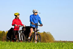 Young sportive couple with mountain bikes Stock Photo
