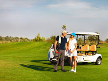 Young sportive couple playing golf on a golf course Stock Photos