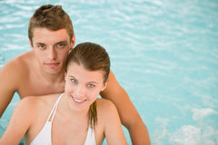 Young sportive couple relax in swimming pool Royalty Free Stock Photo