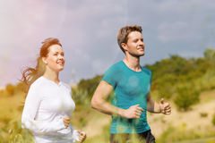 Young sportive couple is running outside Stock Photos
