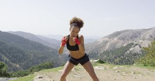 Young sportive female boxer stock video