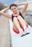 Young sportive girl doing sports outdoors Stock Images