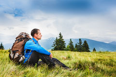 Young sportive hiker trekking in the mountains Royalty Free Stock Images