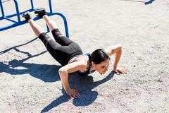 Young sportive teen doing push ups Stock Image