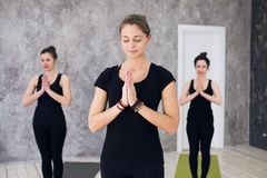 Young sportive trio group of girls are practicing yoga exercises in the studio Royalty Free Stock Photography
