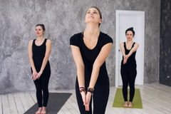 Young sportive trio group of girls are practicing yoga exercises in the studio Royalty Free Stock Photo