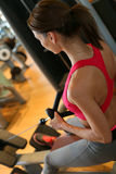 Young sportive woman excercising in a fitness club Stock Image