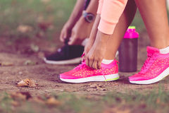Young sportive woman getting ready to start running workout Royalty Free Stock Photo