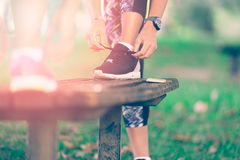 Young sportive woman getting ready to start running workout Royalty Free Stock Photography