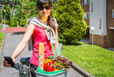 Young sportive woman with groceries in a basket Royalty Free Stock Photography