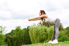 Young sportive woman leaning in park Royalty Free Stock Photo