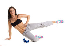 Young sportive woman  training with dumbbels Royalty Free Stock Images