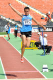 Young sportmen makes long jump Stock Images