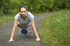 Young sports girl doing warm-up in the Park. Stock Image