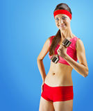 A young sports girl with dumbbell Stock Photography