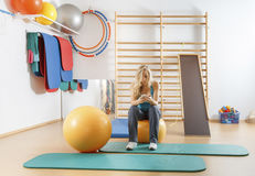 Young sports girl in the gym Royalty Free Stock Photo